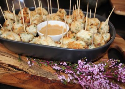 Chicken and corriander balls with peanut dipping sauce
